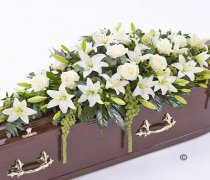 White Lily and White Rose Casket Spray Code: F13520WS | National and Local Delivery