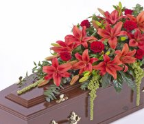 Red Lily and Red Rose Casket Spray Code: F13520RS | National and Local Delivery