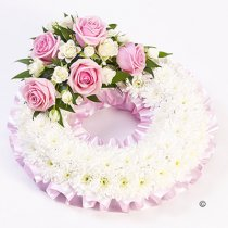 Traditional Pink and White Bassed Wreath Code: F13680PS | National Delivery and Local Delivery Or Collect From Shop