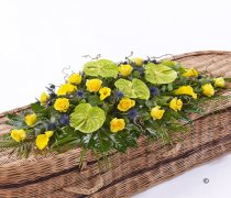 Yellow Green And Blue Woodland Casket Spray Code: F13610YS | National and Local Delivery