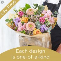 Lily Free Florists Choice Hand tied bouquet made with seasonal flowers Code: LFHT2S | National Delivery and Local Delivery Or Collect From Shop