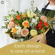 Lily Free Florists Choice Hand tied bouquet made with seasonal flowers Code: LFHT7S | National Delivery and Local Delivery Or Collect From Shop
