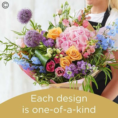 Lily Free Florists Choice Hand tied bouquet made with seasonal flowers Code: LFHT9S | National Delivery and Local Delivery Or Collect From Shop