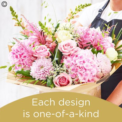 Lily Free Florists Choice Hand tied bouquet made with seasonal flowers Code: LFHT10S | National Delivery and Local Delivery Or Collect From Shop